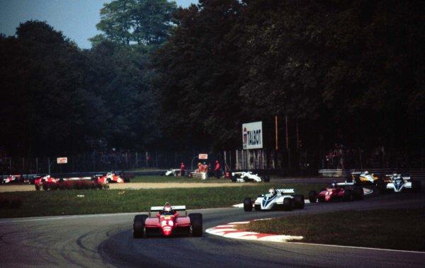 1982 Italian Grand Prix.Monza, Italy.10-12 September 1982.Mario Andretti (Ferrari 126C2) leads at the start.  Ref: 82ITA01. World Copyright - LAT Photographic