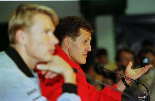 1998 Luxembourg Grand PrixNurburgring, Germany. 25-27 September 1998.Michael Schumacher (Ferrari) and Mika Hakkinen (McLaren Mercedes-Benz) in the press conference.World Copyright - Steve Etherington/LAT Photographic