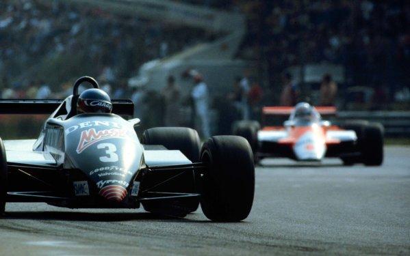 1982 Italian Grand Prix.Monza, Italy.10-12 September 1982.Michele Alboreto (Tyrrell 011 Ford) leads Niki Lauda (McLaren MP4/1B Ford). Alboreto finished in 5th position.  Ref: 82ITA12. World Copyright - LAT Photographic