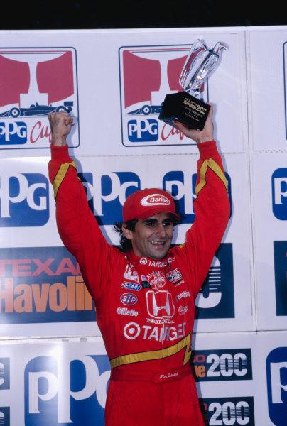 1997 PPG CART World Series.Road America, Elkhart Lake, Wisconsin, USA.16-17 August 1997. Alessandro Zanardi (Chip Ganassi Racing) celebtrates his 1st position on the podium.World Copyright - LAT Photographic