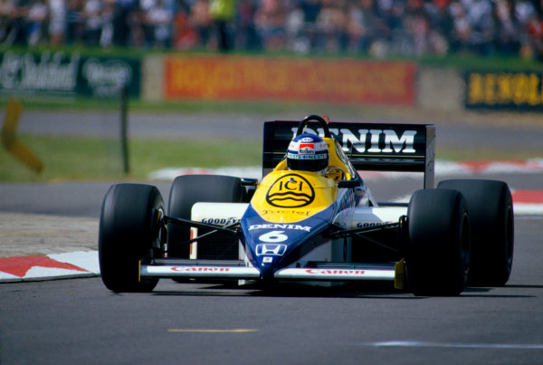 Silverstone, England.19 - 21 July 1985.Keke Rosberg (Williams FW10 Honda) who's pole position time was the fastest ever qualifying lap, action.World Copyright:  LAT PhotographicRef: 85GB