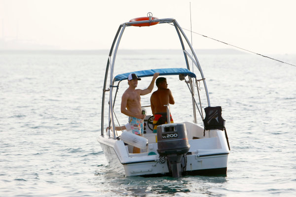 Yas Marina Circuit, Abu Dhabi, United Arab Emirates28th October 2009.World Champion F1 driver Jenson Button takes physio Mike Collier out of the gym for a shot at wakeboarding. More used to climbing hills on their bikes together, Jenson enjoyed the spectacle from the boat and gave his close advisor some tips of his own. Jenson has been preparing for the Abu Dhabi race from Dubai over the past week where he has been reunited with girlfriend Jessica Michibata.World Copyright: Charles Coates/LAT Photographic ref: Digital Image _26Y5720
