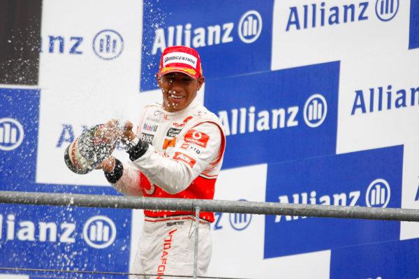 Spa-Francorchamps, Spa, Belgium 29th August 2010 Lewis Hamilton, McLaren MP4-25 Mercedes, 1st position, sprays the victory Champagne. Portrait. Podium.  World Copyright: Charles Coates/LAT Photographic ref: Digital Image _26Y6843