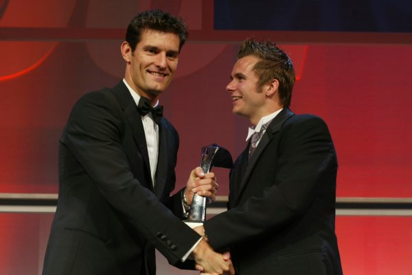 2003 AUTOSPORT AWARDS, The Grosvenor, London. 7th December 2003. Dan Wheldon accepts the award for Rookie of the year from Mark Webber. Photo: Peter Spinney/LAT Photographic Ref: Digital Image only