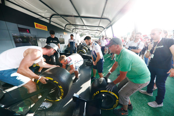 Red Bull Ring, Spielberg, Austria. Saturday 08 July 2017. Fans take part in the Pit Stop Challenge in the F1 fan village. World Copyright: Glenn Dunbar/LAT Images ref: Digital Image _X4I8284