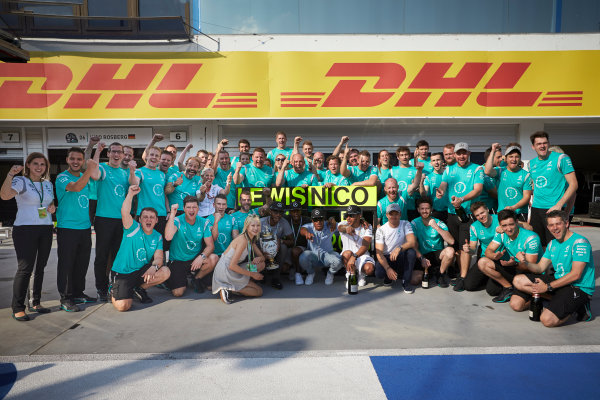 Hungaroring, Budapest, Hungary. Sunday 24 July 2016. Lewis Hamilton and Nico Rosberg celebrate with the Mercedes AMG team after the race. World Copyright: Steve Etherington/LAT Photographic ref: Digital Image SNE27576