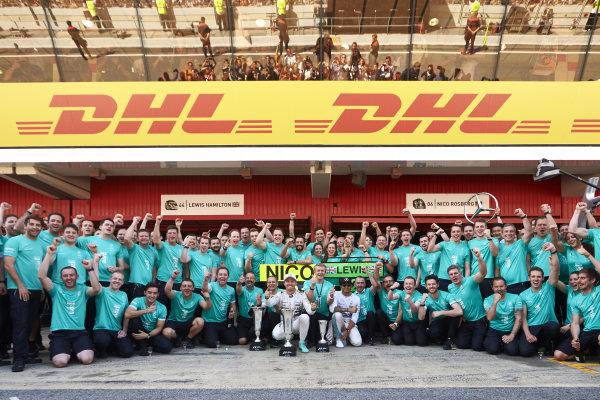 Circuit de Catalunya, Barcelona, Spain. Sunday 10 May 2015. Nico Rosberg, Mercedes AMG, 1st Position, and Lewis Hamilton, Mercedes AMG, 2nd Position, celebrate with their team. World Copyright: Steve Etherington/LAT Photographic. ref: Digital Image SNE10283