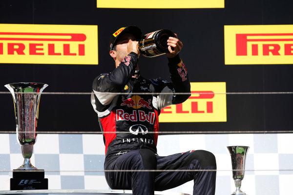 Hungaroring, Budapest, Hungary. Sunday 26 July 2015. Daniel Ricciardo, Red Bull Racing, 3rd Position, downs some Champagne on the podium. World Copyright: Glenn Dunbar/LAT Photographic ref: Digital Image _W2Q1187