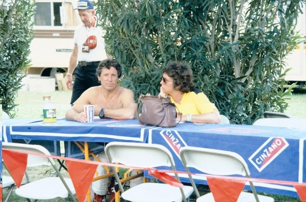 Caesars Palace, Las Vegas, USA. 23rd - 25th September 1982.Mario Andretti (Ferrari 126C2), retired, relaxes with his wife, Dee Ann, in the paddock, portrait. World Copyright: LAT PhotographicRef: 82LV
