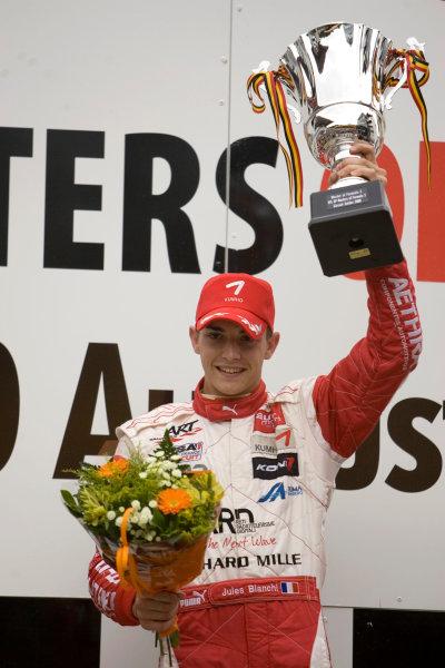 Jules Bianchi, ART Grand Prix celebrates on the podium after winning the race.Portrait.  World Copyright: Drew Gibson/LATref: Digital Image MQ9M3733