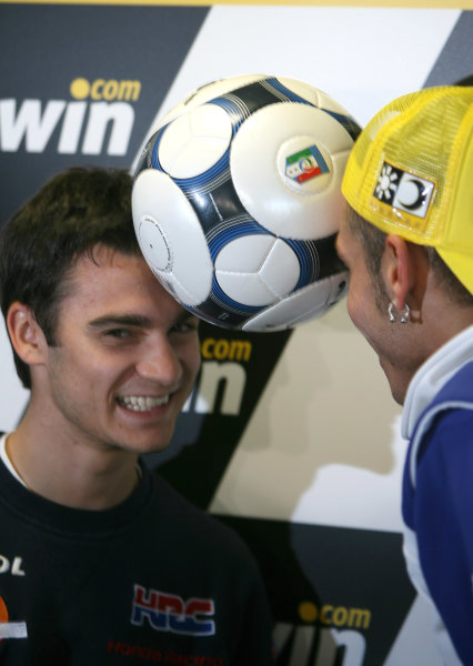Donington Park, England. 18th June 2008.Preview Day.Dani Pedrosa and Valentino Rossi square up for their respective countries ahead of the Spain v Italy Euro Quarter Final .World Copyright: Martin Heath/ LAT Photographicref: Digital Image