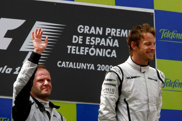 Circuit de Catalunya, Barcelona, Spain10th May 2009Jenson Button, Brawn GP BGP001 Mercedes and Rubens Barrichello, Brawn GP BGP001 Mercedes celebrate on the podium. Portrait.World Copyright: Charles Coates/LAT Photographicref: Digital Image _26Y8617