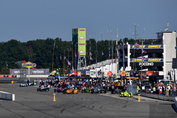 20-21 August, 2016, Long Pond, Pennsylvania USA Union Jack flags fly over pit lane in memory of Justin Wilson  ?2016, Scott R LePage  LAT Photo USA