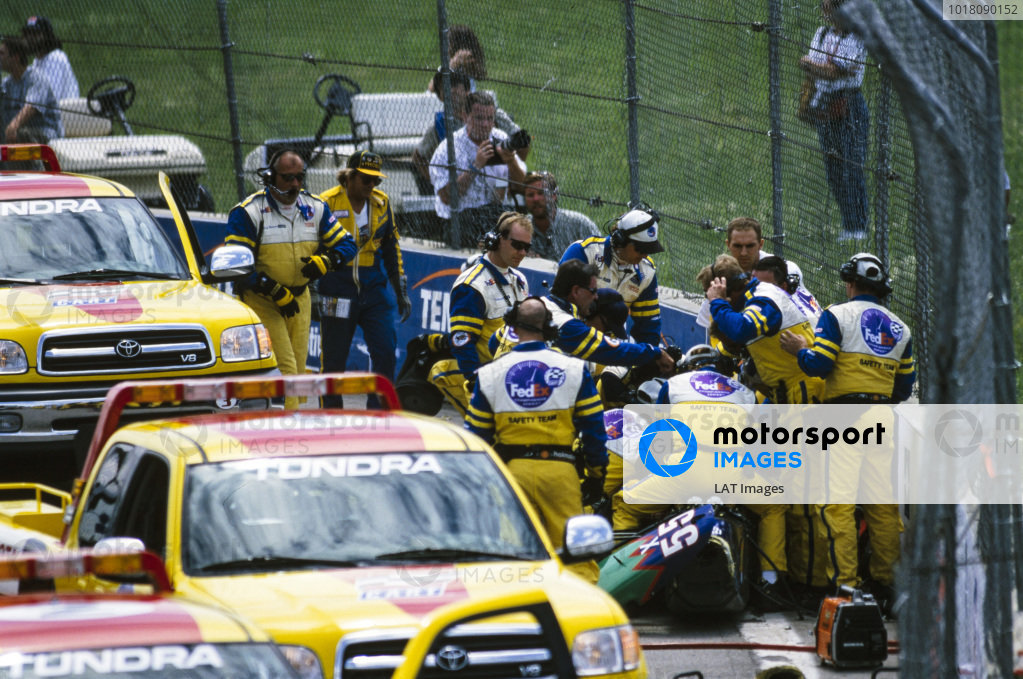 The CART safety team attends Tony Kanaan, Mo Nunn Racing, Reynard 2KI Mercedes.