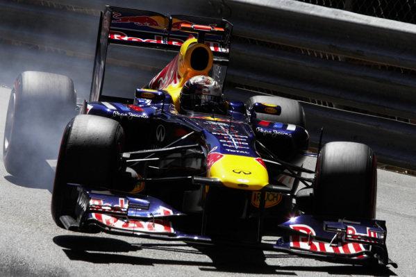 Sebastian Vettel, Red Bull RB7 Renault, locks up a tyre.