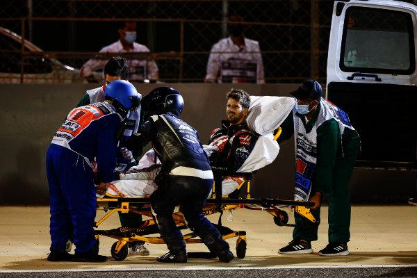 Romain Grosjean, Haas F1, is taken away on a stretcher after his opening lap crash
