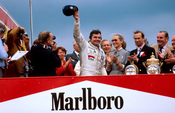 1980 British Grand Prix.Brands Hatch, England.11-13 July 1980.Alan Jones (Williams Ford) celebrates 1st position on the podium. TRH Prince and Princess Michael of Kent stand to the right.Ref-80 GB 06.World Copyright - LAT Photographic