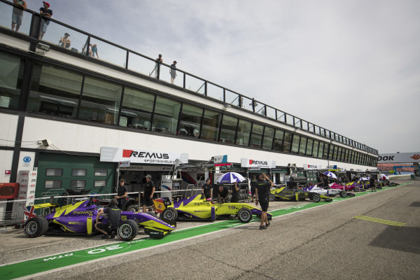 Cars all line up in the pit lane
