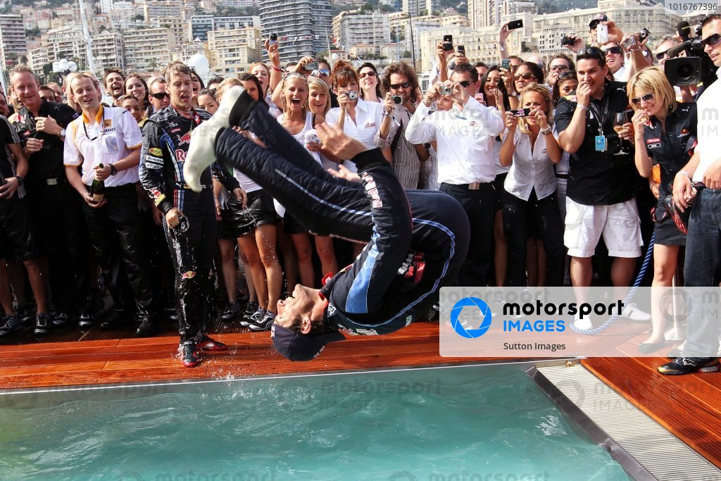 Race winner Mark Webber (AUS) Red Bull Racing celebrates with a back flip into the Red Bull Energy Station pool. Formula One World Championship, Rd 6, Race, Monaco Grand Prix, Monte-Carlo, Monaco, Sunday 16 May 2010.  BEST IMAGE