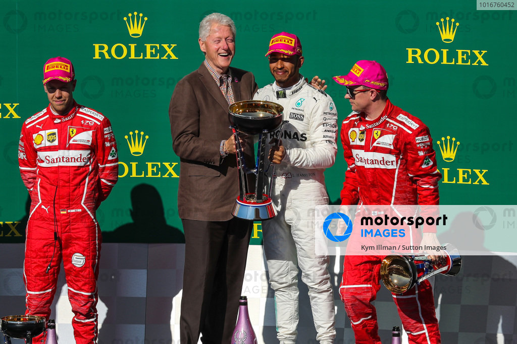 Race winner Lewis Hamilton (GBR) Mercedes AMG F1 celebrates on the podium with Bill Clinton (USA), Sebastian Vettel (GER) Ferrari, Kimi Raikkonen (FIN) Ferrari and the trophy at Formula One World Championship, Rd17, United States Grand Prix, Race, Circuit of the Americas, Austin, Texas, USA, Sunday 22 October 2017. BEST IMAGE