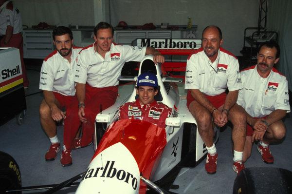 Ayrton Senna, McLaren MP4-8 Ford with McLaren mechanics in the garage.
