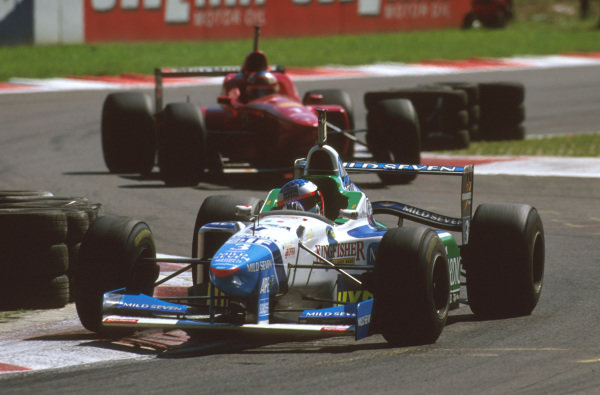 Monza, Italy.6-8 September 1996.Jean Alesi (Benetton B196 Renault) at the Rettifilo Chicane with Michael Schumacher (Ferrari F310) following.Ref-96 ITA 15.World Copyright - LAT Photographic