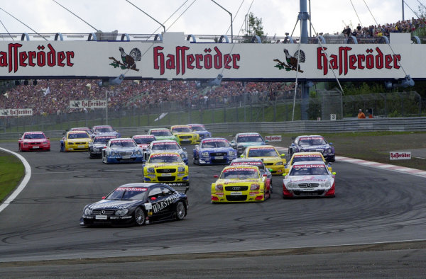 2002 DTM Championship Nurburgring, Germany. 2th - 4th August 2002. Uwe Alzen (Mercedes CLK-DTM) leads Laurent Aiello (Abt Audi TT-R) and Bernd Schneider at the start of the race.World Copyright: Andre Irlmeier/LAT Photographic