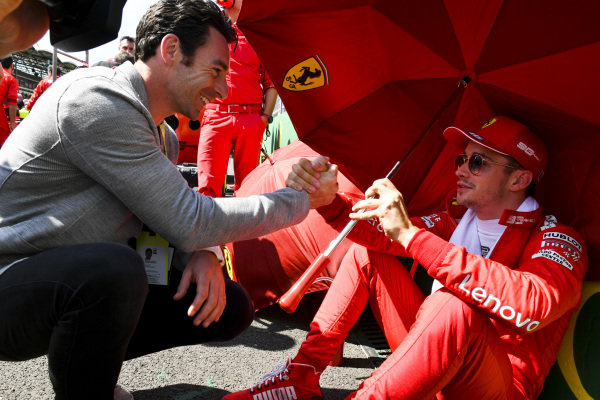 Indy 500 winner Simon Pagenaud talks to Charles Leclerc, Ferrari