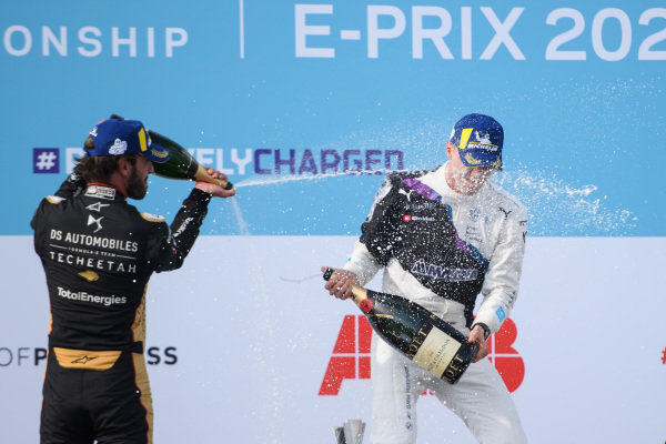 Jean-Eric Vergne (FRA), DS Techeetah, 2nd position, and Maximilian Guenther (DEU), BMW I Andretti Motorsport, 1st position, celebrate on the podium with Champagne