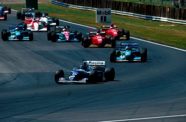 1994 British Grand Prix.Silverstone, England.8-10 July 1994.Damon Hill (Williams FW16 Renault) leads Michael Schumacher (Benetton B194 Ford), Gerhard Berger (Ferrari 412T1), Rubens Barrichello (Jordan 194 Hart), Jean Alesi (Ferrari 412T1) and Jos Verstappen (Benetton B194 Ford) at the start.Ref-94 GB 12.World Copyright - LAT Photographic