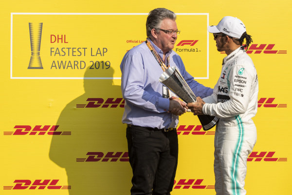 Lewis Hamilton, Mercedes AMG F1, celebrates with the DHL Fastest Lap trophy