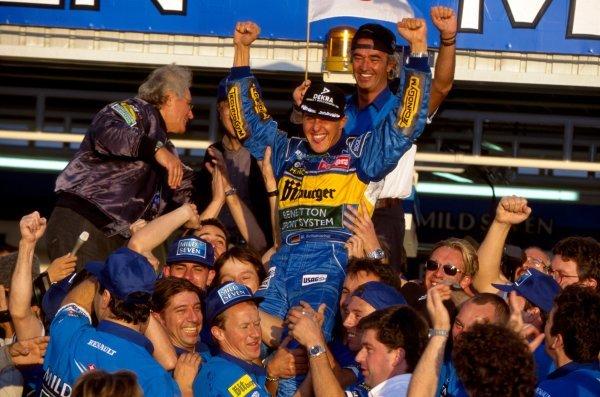 Michael Schumacher (GER) Benetton celebrates his win with the team. Pacific Grand Prix, TI Circuit Aida, Japan, 22 October 1995. DIGITAL IMAGE