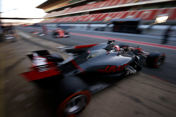 Circuit de Barcelona Catalunya, Barcelona, Spain. Tuesday 07 March 2017. Kevin Magnussen, Haas VF-17 Ferrari, leaves the garage as Sebastian Vettel, Ferrari SF70H, returns. World Copyright: Sam Bloxham/LAT Images ref: Digital Image _SLB3727