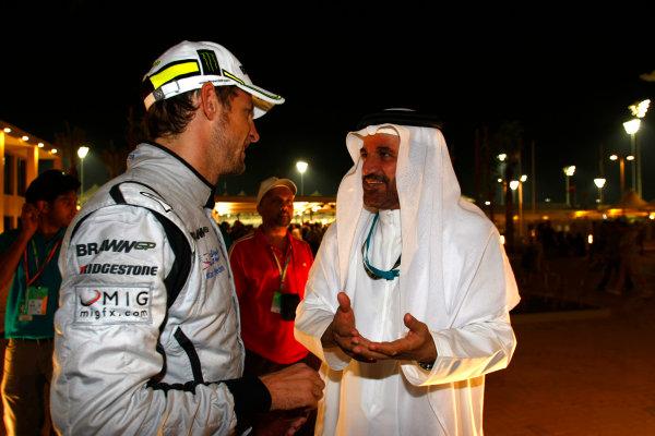 Yas Marina Circuit, Abu Dhabi, United Arab Emirates1st November 2009.Jenson Button, Brawn GP BGP001 Mercedes, 3rd position, with Mohammed Bin Sulayem. Portrait. VIPs.World Copyright: Charles Coates/LAT Photographic ref: Digital Image _26Y3166