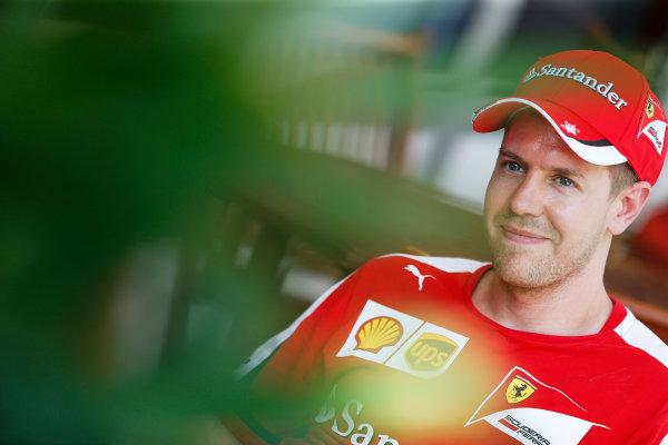 Sepang International Circuit, Sepang, Kuala Lumpur, Malaysia. Thursday 26 March 2015. Sebastian Vettel, Ferrari. World Copyright: Charles Coates/LAT Photographic. ref: Digital Image _N7T2462