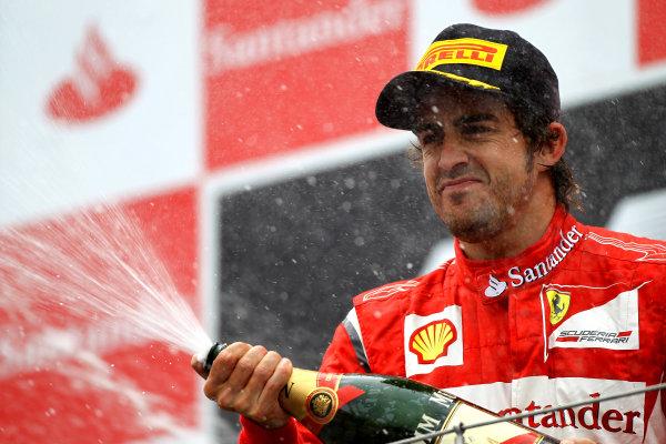 Nurburgring, Germany.24th July 2011Fernando Alonso, Ferrari 150° Italia, 2nd position, sprays the Champagne. Portrait. Podium. World Copyright: Andy Hone/LAT Photographicref: Digital Image CSP13479