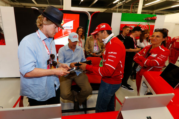 Silverstone, Northamptonshire, UK.  Sunday 16 July 2017. Owen Wilson and Woody Harrelson receive a tour of the Ferrari garage from Sergio Marchionne, Chief Executive Officer, Fiat Chrysler and Chairman, Ferrari. Gene. World Copyright: Glenn Dunbar/LAT Images  ref: Digital Image _X4I7187