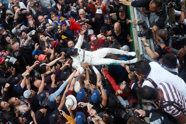 Silverstone, Northamptonshire, UK.  Sunday 16 July 2017. Lewis Hamilton, Mercedes AMG, celebrates with the fans after winning the race. World Copyright: Steve Etherington/LAT Images  ref: Digital Image SNE10448