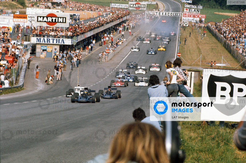 1973 Austrian Grand Prix.  Osterreichring, Austria. 17-19th August 1973.  Ronnie Peterson, Lotus 72E Ford, leads as Denny Hulme, McLaren M23 Ford, passes Emerson Fittipaldi, Lotus 72E Ford, for 2nd position at the start.  Ref: 73AUT56. World Copyright: LAT Photographic