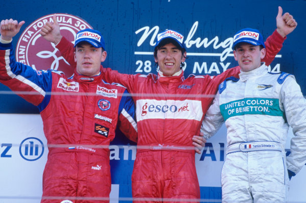 2004 Formula 3000 Championship (F3000) Nurburgring, Germany. 29th May 2004. Enrico Toccacelo (BCN F3000), Robert Doornbos (Arden International) and Yannick Schroeder (Durango Formula) celebrate on the podium.World Copyright: Peter Spinney/LAT Photographic ref: 35mm Image A15