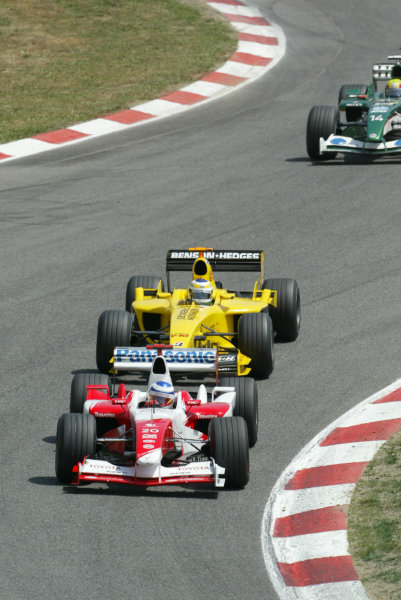 2003 Spanish Grand Prix - Sunday Race,Barcelona, Spain.4th May 2003.Olivier Panis, Toyota TF103, leads Giancarlo Fisichella, Jordan Ford EJ13, action.World Copyright LAT Photographic.ref: Digital Image Only.
