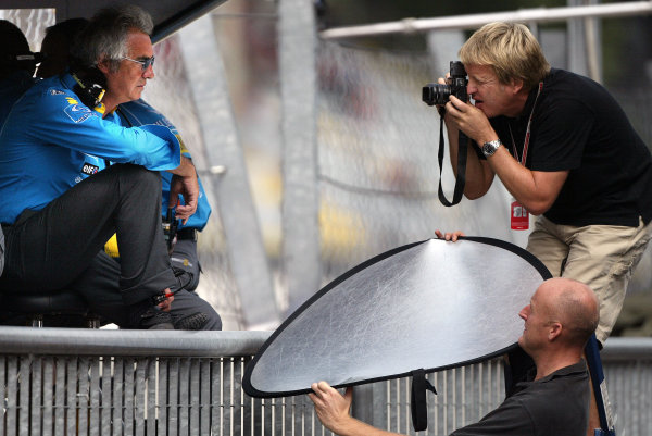 2004 Italian Grand Prix - Friday Practice,Monza, Italy. 10th September 2004 Flavio Briatore, Renault, has his portrait taken bt LAT snapper Steven Tee, and Charles Coates (Toots).World Copyright: Steve Etherington/LAT Photographic ref: Digital Image Only