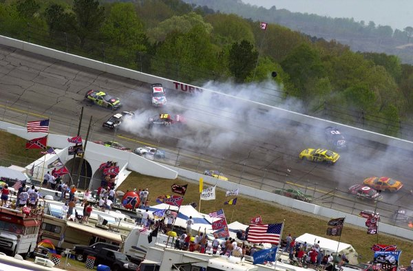 NASCAR Winston Cup Aaron's 499, Talladega Superspeedway, Talladega,Alabama, USA 6 April,2003A tire sails over the Turn 2 wall. Thankfully no one was injured by its exit.-Lori M Spitler/LAT Photographic 2003