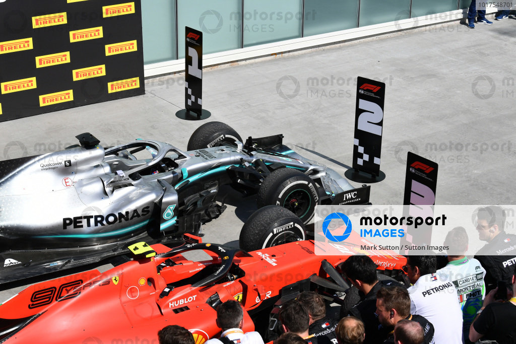 The cars of Lewis Hamilton, Mercedes AMG F1 W10, 1st position, and Charles Leclerc, Ferrari SF90, 3rd position, in Parc Ferme, after the position marker signs had been switched by Sebastian Vettel, Ferrari, 2nd position