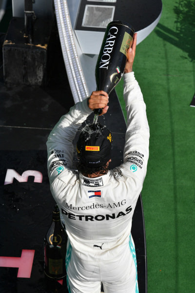 Lewis Hamilton, Mercedes AMG F1, 1st position, drinks Champagne on the podium