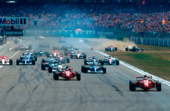 1994 German Grand Prix.Hockenheim, Germany.29-31 July 1994.Gerhard Berger leads teammate Jean Alesi (both Ferrari 412T1B's), Ukyo Katayama (Tyrrell 022 Yamaha), Damon Hill (Williams FW16 Renault) and Michael Schumacher (Benetton B194 Ford) at the start. Behind Alessandro Zanardi (Lotus 109 Mugen-Honda) goes straight into the pit wall after being hit by Andrea de Cesaris. Behind him is Pierluigi Martini (Minardi M194 Ford). On the right is where Andrea de Cesaris (Sauber C13 Mercedes) ends up managing to take out Michele Alboreto in the other Minardi M194 Ford as well.Ref-94 GER 01.World Copyright - LAT Photographic