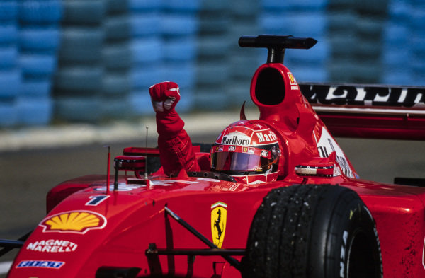 Michael Schumacher, Ferrari F2001, celebrates securing the race victory and with it his fourth world drivers' championship.