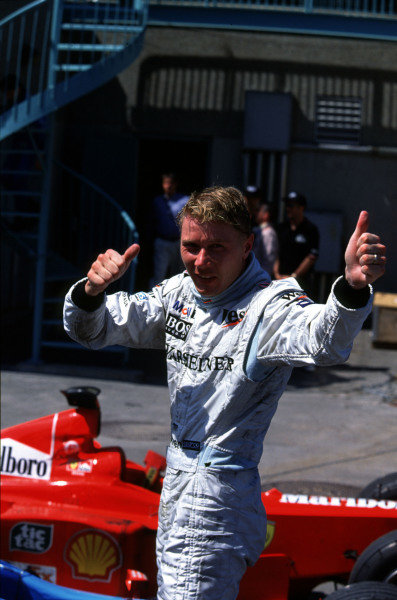1999 Canadian Grand Prix.Montreal, Quebec, Canada.11-13 June 1999.Mika Hakkinen (McLaren Mercedes) celebrates his 1st position in parc ferme.Ref-99 CAN 01.World Copyright - LAT Photographic