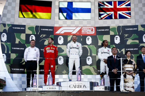 Sebastian Vettel, Ferrari, Race winner Valtteri Bottas, Mercedes AMG F1 and Lewis Hamilton, Mercedes AMG F1 on the podium