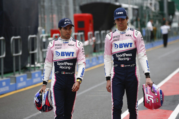 Sergio Perez, Racing Point, and Lance Stroll, Racing Point, in the pits